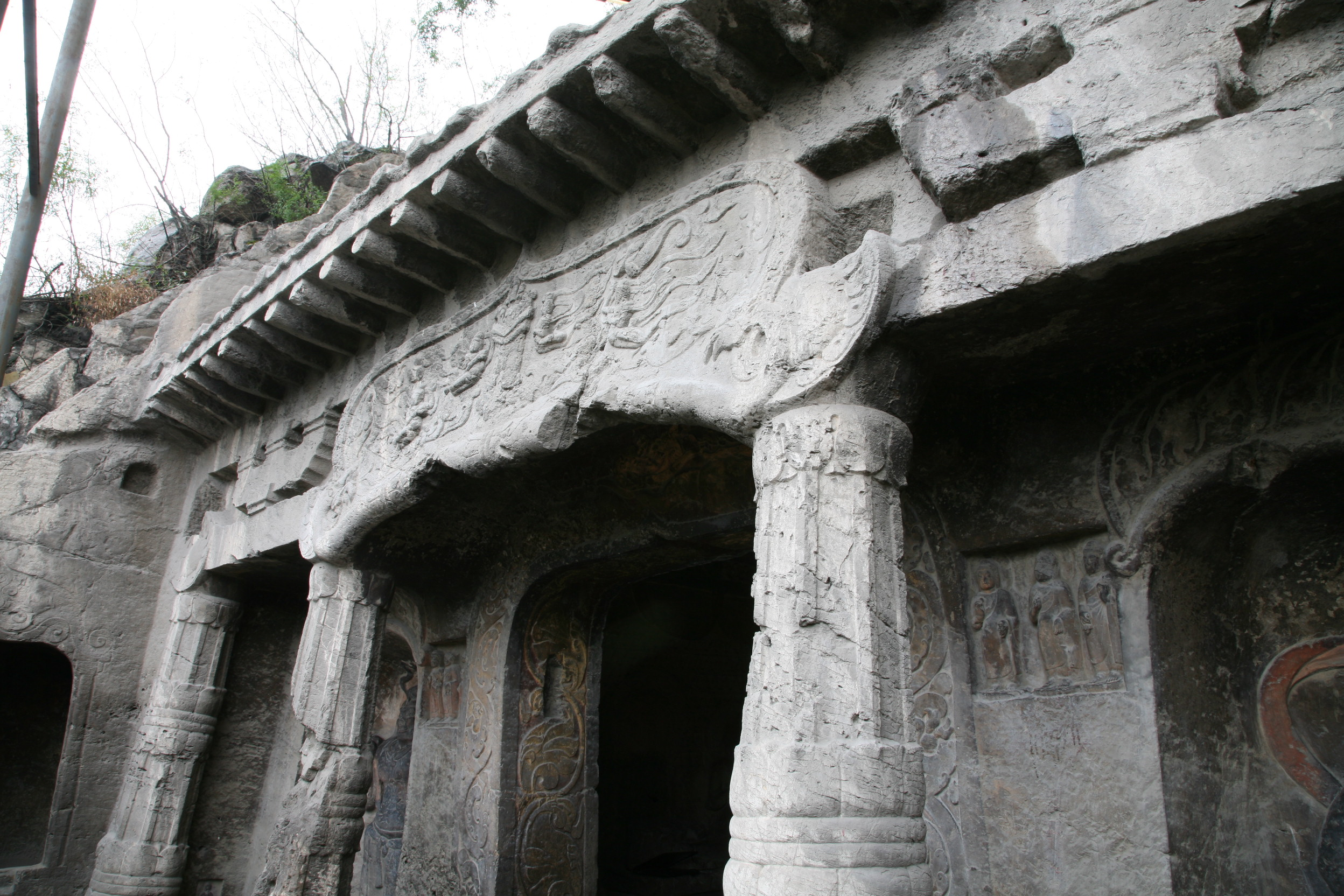 Xiangtangshan Cave 7 exterior, carved stone columns, brackets, and eave