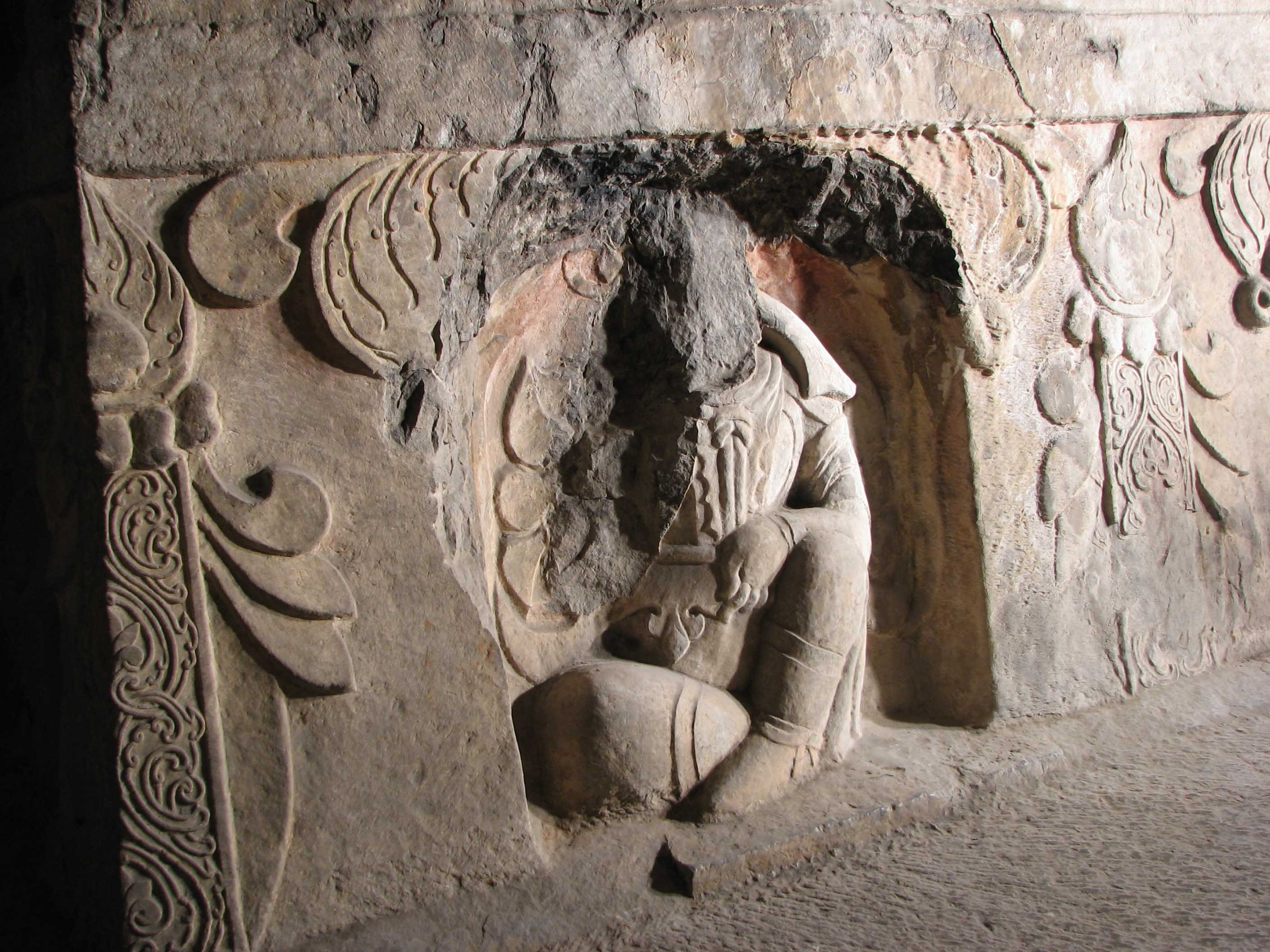 Xiangtangshan Middle Cave central pillar north, River Spirit King holding a fish